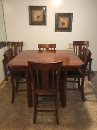 Dining room table with drop leaves and 6 chairs at bar level.