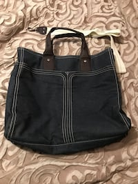 Large denim bag with two huge pockets in front. Never used.. Cookeville, 38506