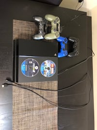 black Sony PS4 with two controllers Woodbridge, 22192