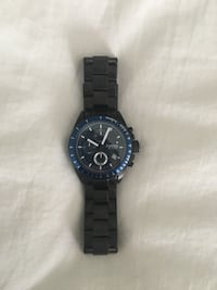 round blue Fossil chronograph watch with black link band Southington, 06489