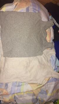 two grey and white tank tops