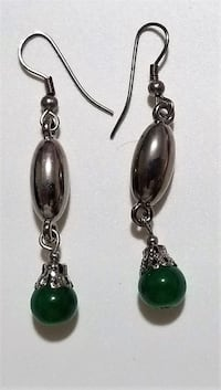 Pair of green gemstone encrusted earrings