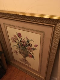 brown-framed painting of flowers in footed vase
