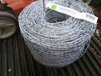 Brand new roll of barbed wire