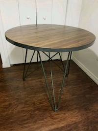 round brown wooden table with black metal base Greater Northdale, 33624