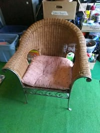 Wicker and rod iron chair