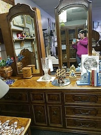 brown wooden drawers dresser with mirror