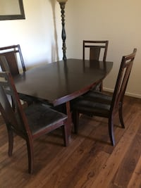 rectangular brown wooden table with four chairs dining set Tucson, 85713