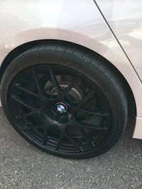 Black 5-spoke car wheel with tire Vaughan, L6A 0N3