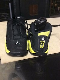 pair of black-and-green Nike basketball shoes Douglasville, 30134