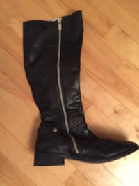 pair of black leather knee-high boots MONTREAL