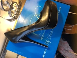 pair of black leather heeled shoes with box