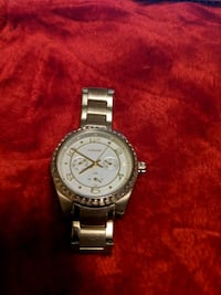 round silver-colored chronograph watch with link bracelet 543 km