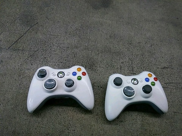 two white Xbox 360 controllers