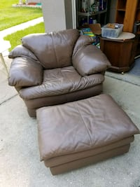Brown leather chair and ottoman  Inverness