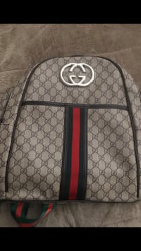 Gucci backpack. very clean with 2 pockets.$90 obo