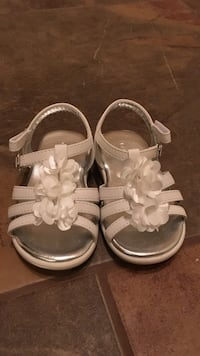 toddler's pair of white leather sandals