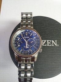 Men's Citizen Eco Drive watch blue face