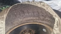 gray vehicle wheel and tire Laval, H7W 0H2