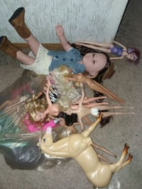 Assorted barbies, Barbie clothes,and doll Cabot
