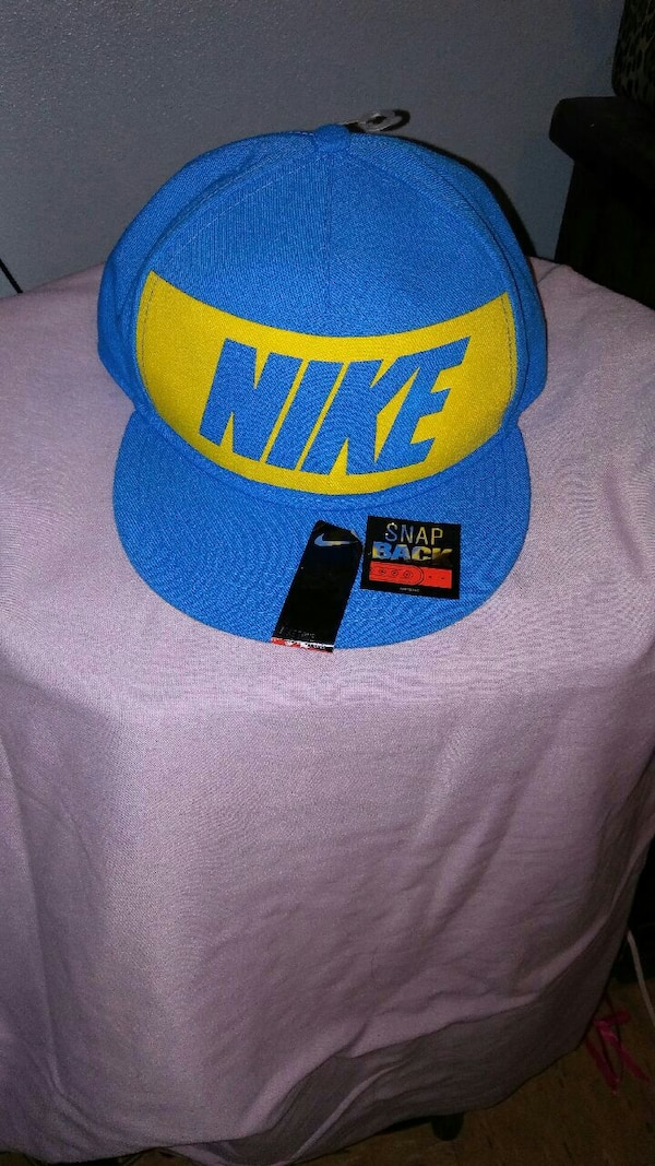Used blue and yellow Nike snap back cap for sale in Shawnee - letgo b3b97da8846