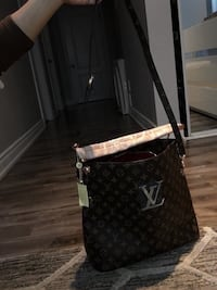 black and gray Louis Vuitton leather crossbody bag Mississauga, L5W 1S9