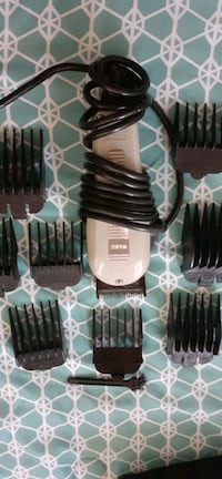 Wahl hair cutters 9 attachments like new.