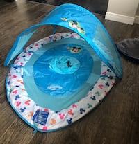 Swimways Disney baby floating device. Used a handful of times on a Florida trip. Works great.  Oshawa, L1K 0M3