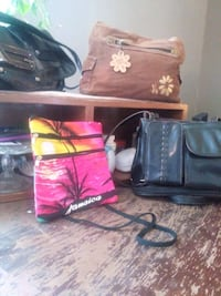 two black and red leather bags Medicine Hat, T1A 7M1
