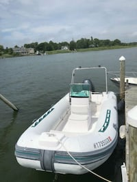 white and green personal watercraft Holtsville, 11742