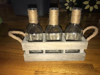 Three glass jar and wooden holder