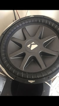 Black and gray kicker subwoofer 866 mi