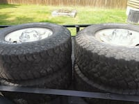 Four black auto wheel with tires Youngstown, 44514
