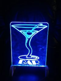 bar light up blue neon sign on wooden stand