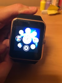 Black and gold smart watch  550 km