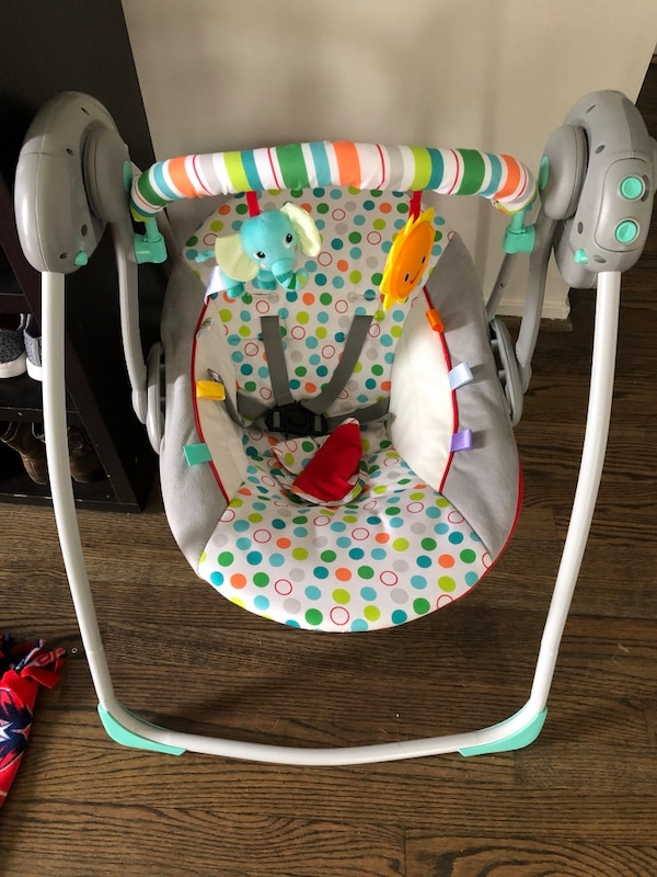 baby's white and green swing chair