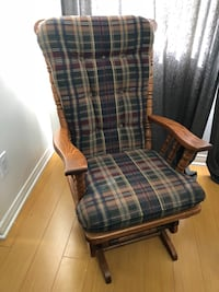 brown wooden framed blue and white plaid padded armchair