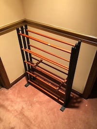 black and brown wooden shoe rack