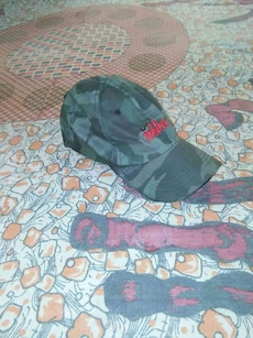 grey and green camouflage snap back cap