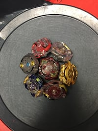 8 beyblades with stadium and launchers. Oceanside, 92056