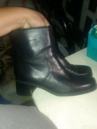 pair of black leather boots Alameda