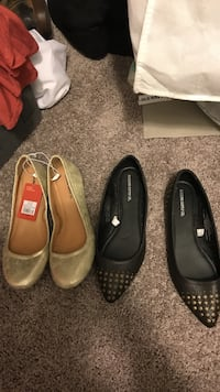 two pairs of black and white leather flats Easley, 29642