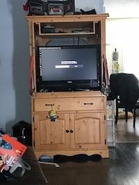 Brown wooden tv hutch with flat screen television Calgary, T3K 4R4