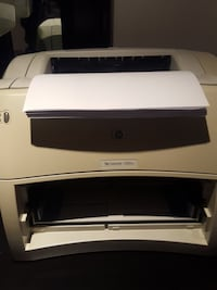 gray and white HP multi-function printer