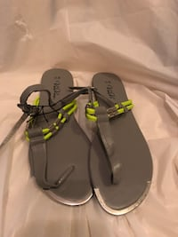 pair of gray VeeVee tong sandals