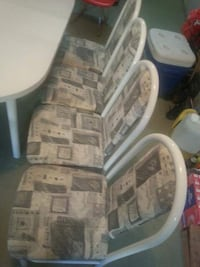 White and grey table and 4 chair can extend the table. OBO Surrey, V4N 0Z5