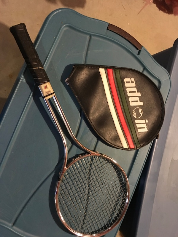 Add in tennis racket with case