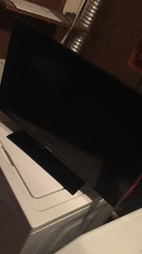 black flat screen TV with remote Frederick, 21702