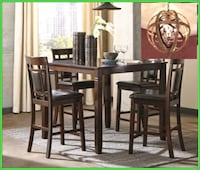 rectangular brown wooden table with four chairs di Alvin, 77511