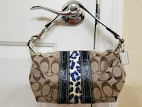 Small Coach labeled Handbag